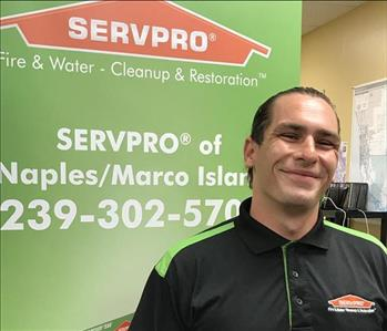 male employee with brown hair and a black SERVPO shirt