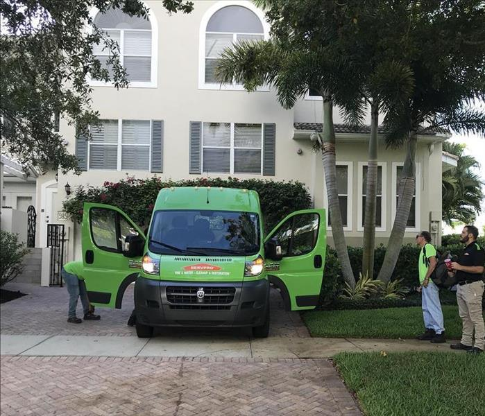 SERVPRO green fleet van at a home