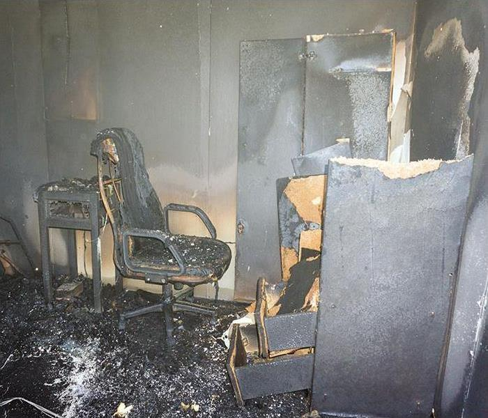 furniture in room after burned by fire with smoke damage
