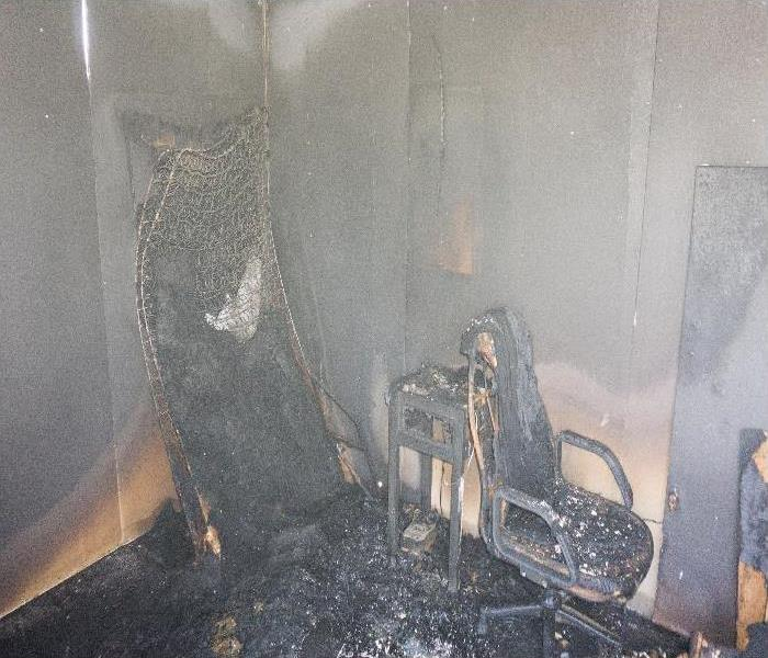 chair and furniture in room after burned by fire